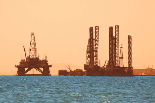 oil rig during sunset in caspian sea