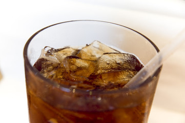 soft drink with ice and straw