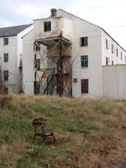old schoolchair in field