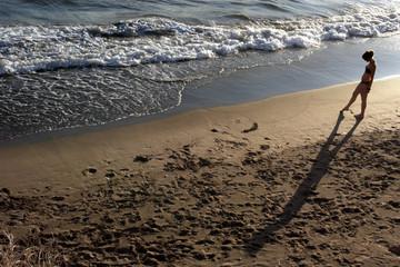 girl strolling at beach