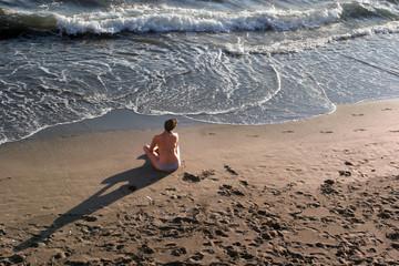 girl sitting at beach