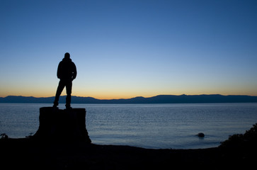 man in front on lake