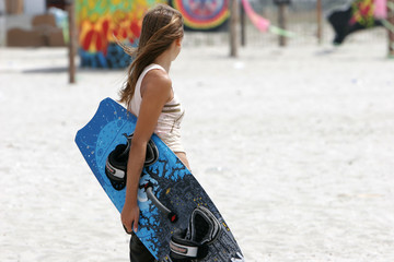 young girl with kite board
