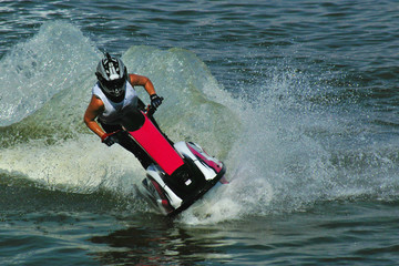 Foto op Canvas Water Motor sporten riding a jetski in water drops