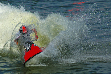 Garden Poster Water Motor sports someone riding a jetski surrounded with water drop