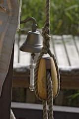 block and bell on a old sailboat.