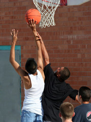 boys reaching for basket