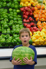 boy surprised with watermelon