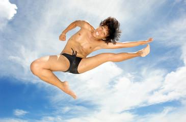 tropical acrobat on beach.