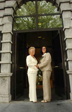 lesbian brides in front of town hall after marriag