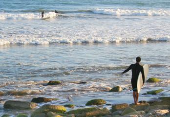 surfer on the rocks