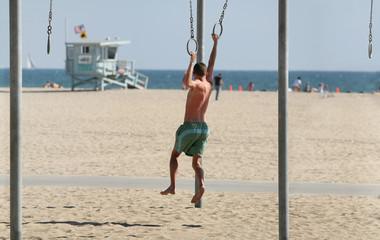 teen exercising on beach