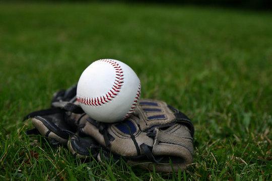 baseball on top of glove horizontal