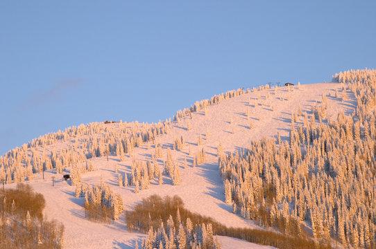 sunset on ski slopes at winter