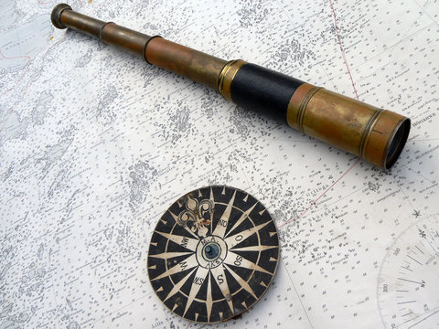 compass and monocular on map