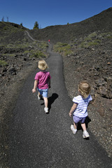 two little girls walking
