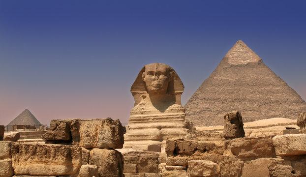 sphinx guarding a pyramid