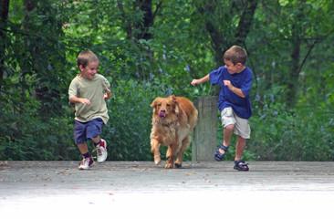 boy racing dog