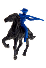 toy cowboy on horse