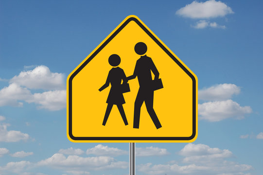 school warning sign with clouds