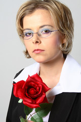 blond woman with glasses and red rose