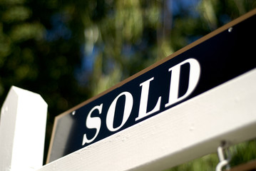 sold sign in front of house or condo