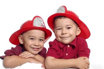 boys wearing firefighter hats
