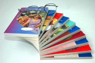 paperbacks and reading glasses