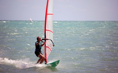 older male windsurfer