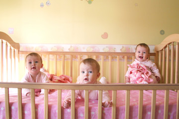 baby girls in crib - triplets