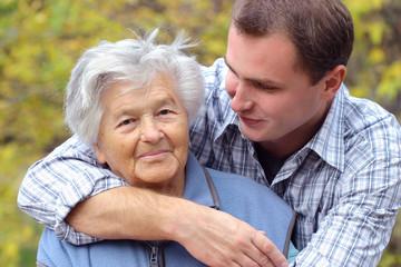 hugging elderly person