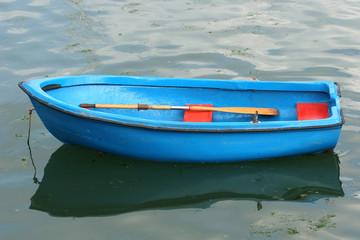 empty blue rowing boat