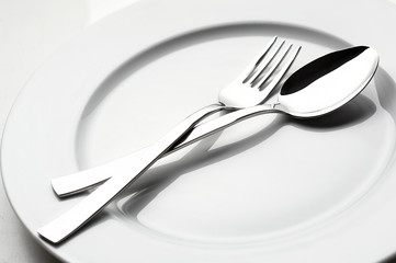 fork and spoon on white plate