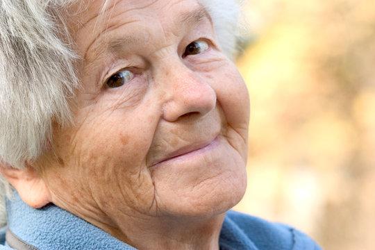 elderly woman smiles