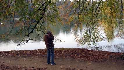 photographer beside lake taking photo
