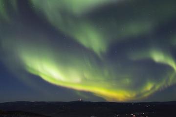 Foto auf Leinwand Violett rapidly growing arc of aurora borealis