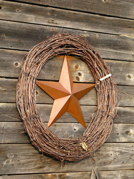 angle view copper star inside a wreath