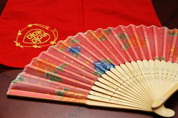 oriental fan and handkerchief