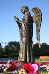 bronze sculpture of a praying angel