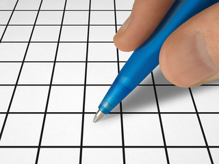 pen in hand and crossword
