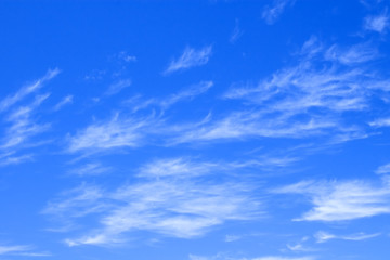 blue sky with delicate clouds