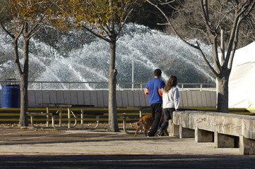 couple walking at fountain