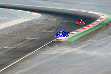 Foto op Canvas Snelle auto s red and blue racing cars