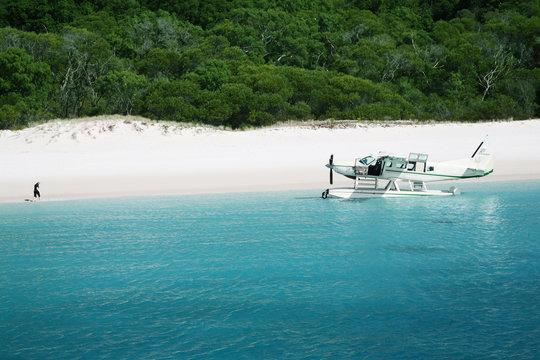 aeroplane arrives on whitehaven beach
