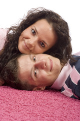 young couple lying on the pink carpet