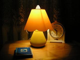 clock, lamp and book