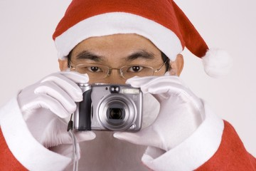 asian santa claus with camera