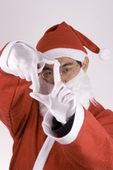 asian santa claus with framing gesture