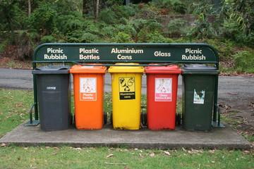 five rubbish bins in a row