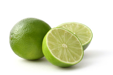 fresh limes on a white back ground